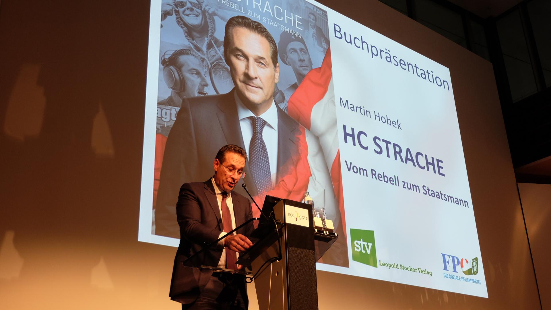 HC Strache-Podium.Graz-Biographie-Präsentation